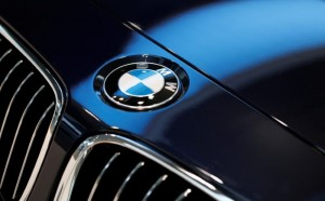 FILE PHOTO: A BMW logo is pictured before the annual news conference of German premium automaker BMW in Munich March 19, 2014.     REUTERS/Michaela Rehle/File Photo